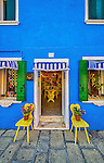 The colourful facade of a shop on the island of Burano in Venice, Italy