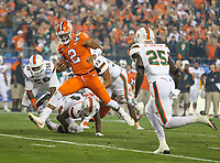 Charlotte, NC - December 2, 2017: Clemson Tigers quarterback Kelly Bryant (2) avoids a tackle during the ACC championship game between Miami and Clemson at Bank of America Stadium in Charlotte, NC. Clemson defeated Miami 38-3 for their third consecutive championship title. (Photo by Elliott Brown/Media Images International)