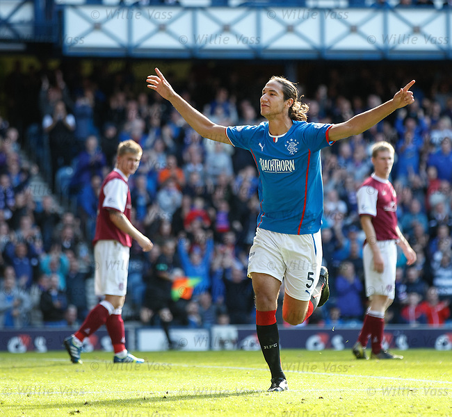 Bilel Mohsni celebrates after scoring for Rangers
