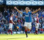 Bilel Mohsni celebrates after scoring for Rangers