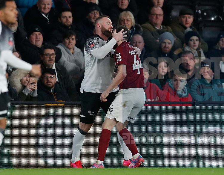 Wayne Rooney of Derby County grabs Paul Anderson of Northampton during the FA Cup match at the Pride Park Stadium, Derby. Picture date: 4th February 2020. Picture credit should read: Darren Staples/Sportimage