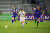 Orlando, FL - Saturday March 24, 2018: Utah Royals midfielder Diana Matheson (10) dribbles away from Orlando Pride midfielder Dani Weatherholt (17) during a regular season National Women's Soccer League (NWSL) match between the Orlando Pride and the Utah Royals FC at Orlando City Stadium. The game ended in a 1-1 draw.