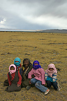 "A Nomad family near Namtso Lake.Namtso Lake :Namtso, another holy lake in Tibet, is located near Damxung. 4718 meters (15475 feet) above sea level and covering 1900 square kilometers (735 square miles), the lake is the highest saltwater lake in the world and the second largest saltwater lake in China. The snow capped Mt. Nyainqentanglha, considered as the son of Namtso and leader of sacred mountains, soars up to sky beside her. Singing streams converge into the clean sapphire blue lake, which looks like a huge mirror framed and dotted with flowers..The Namtso Lake is held as ""the heavenly lake"" or ""the holy lake"" in northern Tibet. .Respected as one of the three holiest lakes in Tibet, the Namtso Lake is the seat of Paramasukha Chakrasamvara for Buddhist pilgrims. In the fifth and sixth month of the Tibetan calendar each year, many Buddhists come to the lake pay homage and pray. Deep tracks are worn into the lakeshore due to this activity. In history, monasteries stood like trees in a forest around the site, attracting large numbers of pilgrims as eminent monks in Buddhist temples extended Buddhist teachings...Buddhists believe Buddhas, Bodhisattvas and Vajras will assemble to hold religious meeting at Namtso in the year of sheep on Tibetan calendar. It is said that walking around the lake at the right moment is 100,000 times more efficacious than that in normal years. That's why thousands of pilgrims from every corner of the world come to pray at the site, with the activity reaching a climax on Tibetan April 15...Walking around the lake takes a week. Ritual walkers love to burn aromatic plants to raise smoke on Auspicious Island [explain this a little] and throw a piece of hada scarf into the lake as a token of fulfilled wishes. If the scarf sinks, it implies ones wish is accepted by the Buddha; if the scarf flows on the water or only half sinks, it means one has failed to be honest and something unhappy may lie ahead...On the four sides of the lake stand four mona"
