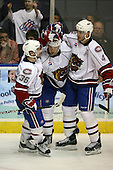 March 15, 2009:  Right Wing Mike Glumac (15) of the Hamilton Bulldgos, AHL affiliate of Montreal Canadians, is congratulated after a goal by Dan Jancevski (4) and David Desharnais (36) during the second period of a regular season game at the Blue Cross Arena in Rochester, NY.  Hamilton defeated Rochester 4-3 in a shoot out.  Photo Copyright Mike Janes Photography 2009