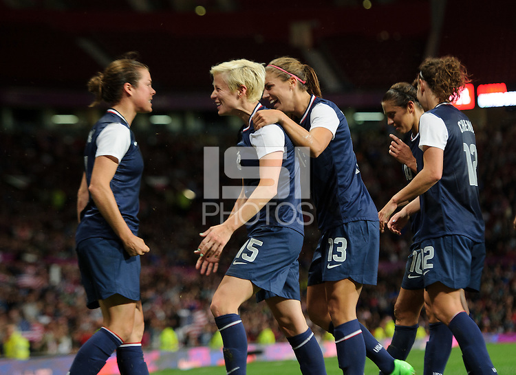 Manchester, England - Monday, August 5, 2012: The USA defeated Canada 4-3 in overtime in the semi-final round of the 2012 London Olympics at Old Trafford. Megan Rapinoe is congratulated after scoring by Kelley O'Hara, and Alex Morgan.