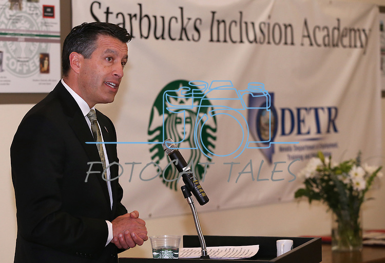 Nevada Gov. Brian Sandoval speaks at a ceremony recognizing the new Starbucks Inclusion Academy at the Starbucks Carson Valley Roasting Plant &amp; Distributions Center in Minden, Nev., on Thursday, Jan. 29, 2015. The program, created by Starbucks and Nevada's Department of Employment, Training and Rehabilitation helps people with disabilities gain work skills and experience. <br /> Photo by Cathleen Allison/Nevada Photo Source