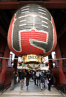 A giant paper lamp hangs at Kaminarimon (thunder gate), the entrance to Senso-Ji temple, in Tokyo, Japan, on November 2, 2006. Senso-Ji is a Buddhist temple. Tokyo, seat of the Japanese government and home of the Japanese Imperial Family, is the Japanese capital, and is ranked fourth global city in the world. Photo by Lucas Schifres/Pictobank