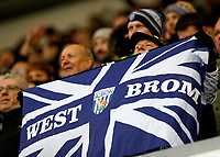 9th February 2020; The Den, London, England; English Championship Football, Millwall versus West Bromwich Albion; West Bromwich Albion fans holds up a giant West Brom union jack flag from the away stands after the final whistle as West Bromwich Albion are top of the 2020/21 Championship