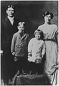 "Photograph of Ronald Reagan (with ""Dutch boy"" haircut) Neil Reagan (brother) and Parents Jack and Nelle Reagan, circa 1914.."