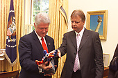 In this photo released by the White House, United States President Bill Clinton accepts the German Media Peace Prize from Karlheinz Koegel, head of the Media Peace Prize Jury, in the Oval Office of the White House in Washington, DC on September 20, 2000.<br /> Mandatory Credit: William Vasta / White House via CNP