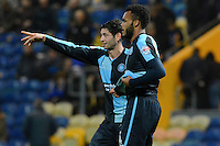 Wycombe Wanderers Joe Jacobson with the scorer of their second goal Aaron Amadi-Holloway during the Sky Bet League 2 match between Mansfield Town and Wycombe Wanderers at the One Call Stadium, Mansfield, England on 31 October 2015. Photo by Garry Griffiths.
