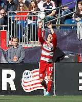 FC Dallas defender Zach Loyd (17) throw in. .  In a Major League Soccer (MLS) match, FC Dallas (red) defeated the New England Revolution (blue), 1-0, at Gillette Stadium on March 30, 2013.
