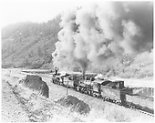 rear 3/4 fireman side view from above of K-36 #487 and K-37 #494 double-heading on Monero Canyon.<br /> D&amp;RGW  Monero Canyon, NM  Taken by Krause, John - 5/1953