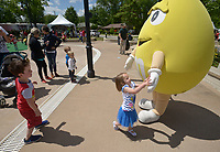 NWA Democrat-Gazette/BEN GOFF @NWABENGOFF<br /> Emily Hess, 3, and brother Joshua Hess, 5, of Lowell meet the yellow M&M Thursday, May 4, 2017, in the Sponsor Village at Compton Gardens during the Bentonville Film Festival.