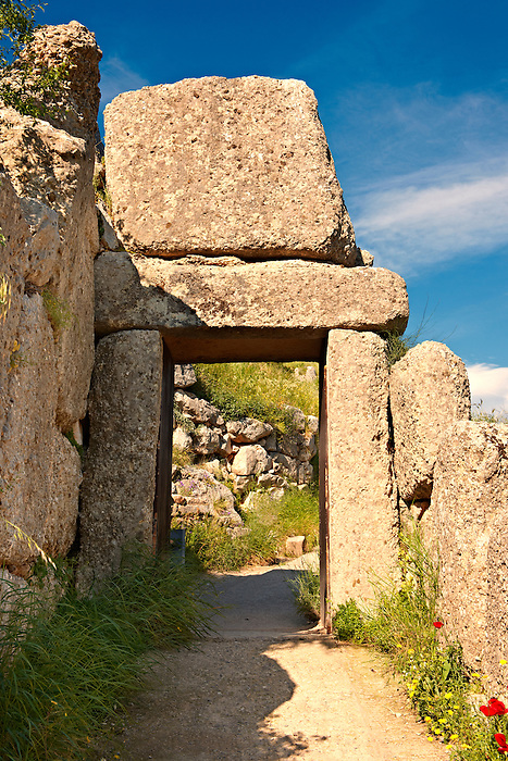 "The North Postern (Gate) of Mycenae ( 1250 B.C). Made from four Monolithic blocks of ""Almond Stone"" in a typical form of two upright jams, A lintel over the top and threshold. Mycenae UNESCO World Heritage  Archaeological Site, Peloponnese, Greece"