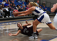 NWA Democrat-Gazette/CHARLIE KAIJO Rogers High School forward Ally Figenskau (34) catches a loose ball as Siloam Springs High School Chloe Price (4) looks to rebound, during the Great 8 Tournament, Thursday, November 29, 2018 at King Arena at Rogers High School in Rogers.
