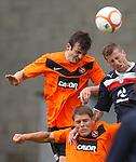 Gavin Gunning and John Rankin of Dundee Utd with Iain Davidson of Dundee