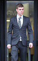 "Pictured: Geraint Evan Jones outside Swansea Crown Court.<br /> Re: A man bit off part of a rugby fan's ear on Halloween while dressed as Colonel Gadaffi, a trial has heard.<br /> Swansea Crown Court heard Geraint Evan Jones carried out a ""cowardly and unprovoked"" attack after being in an Aberystwyth bar for just six minutes.<br /> The prosecution said he approached Gwynant Lewis Jones from behind before sinking his teeth into his left ear.<br /> Mr Jones, 25, admits biting him - but insists he did not mean for the victim's ear to be torn off.<br /> It is the defence's case that Mr Jones' ear lobe was accidentally torn off when a friend stepped in and tried to ""pull"" him away from the defendant."