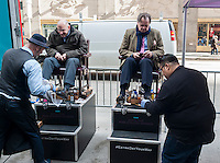 "Passer-by opt for free shoe shines at a promotion for Residence Inns by Marriott tied into today's leap day, Monday, February 29, 2016. The promotional even has been entitled by Marriott, ""#ExtraDayYourWay"" and offered shoe shines,manicures and shaves. (© Richard B. Levine)"