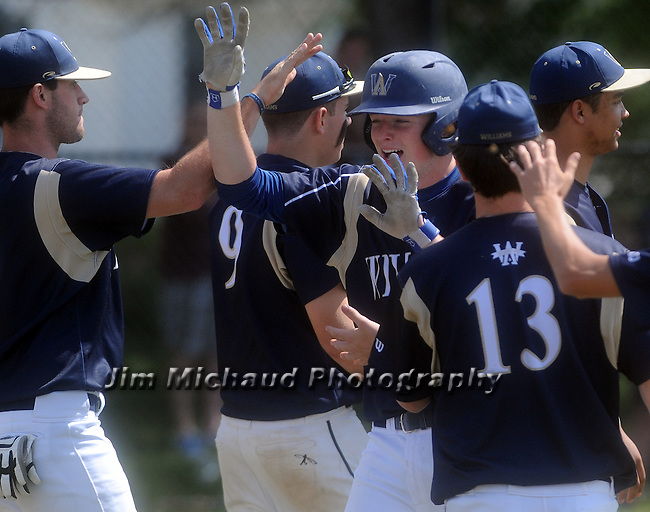 (060615 Bridgewater) Williams 10, Brian Fisher, is all smiles as he's congratulated by teammates after knocking in two runs during a 5 run fifth inning, during the game with West Bridgewater, Saturday, June 6, 2015, in Bridgewater. Herald Photo by Jim Michaud