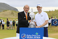 Colm McLoughlin CEO Dubai Duty Free presents the winner Russell Knox (SCO) with the trophy at the end of Sunday's Final Round of the 2018 Dubai Duty Free Irish Open, held at Ballyliffin Golf Club, Ireland. 8th July 2018.<br /> Picture: Eoin Clarke | Golffile<br /> <br /> <br /> All photos usage must carry mandatory copyright credit (&copy; Golffile | Eoin Clarke)