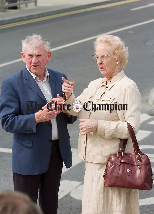 Frank Conway, Fianna Fail activist, greets former senator and Ennis Town council member Tras Honan, now deputy chairperson of the board of Bus Eirreann, at the official opening of the newly refurbished Bus Eireann station at Ennis. Photograph by John Kelly.