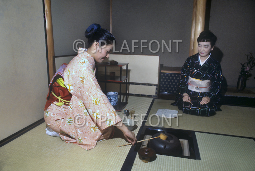 October, 1980. Tokyo, Japan. Women dressed in traditional Japanese Kimono, perform the traditional  Tea Ceremony in the Ginza district of Tokyo.