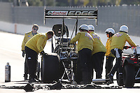 Feb. 15, 2013; Pomona, CA, USA; NHRA safety safari crews tend to top fuel dragster driver Brittany Force during qualifying for the Winternationals at Auto Club Raceway at Pomona. Mandatory Credit: Mark J. Rebilas-