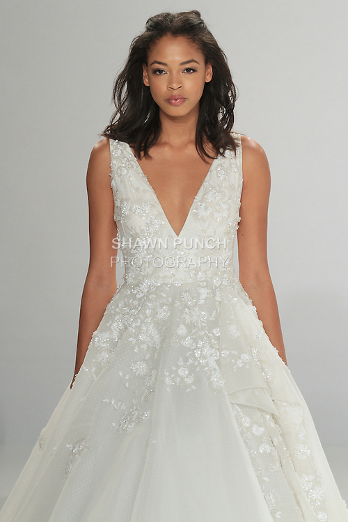 """Model walks runway in Greta - an off white A-line tulle dress featuring white crystal beading foliage, a V-neckline and gathered skirt, from the Tony Ward Fall 2016 """"A Mid-Summer Night's Dream"""" bridal collection on April 18, 2016 at Kleinfeld Bridal during New York Bridal Fashion Week Spring Summer 2016."""