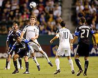 LA Galaxy defender Todd Dunivant (2) beats San Jose Earthquake forward Chris Wondolowski (8) to the ball. The LA Galaxy and the San Jose Earthquakes played to a 2-2 draw at Home Depot Center stadium in Carson, California on Thursday July 22, 2010.