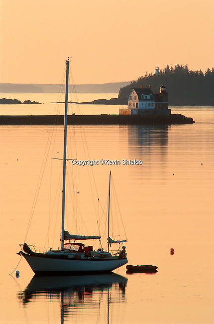 Sailboat at anchor and two lighthouses, Rockland, Maine, USA