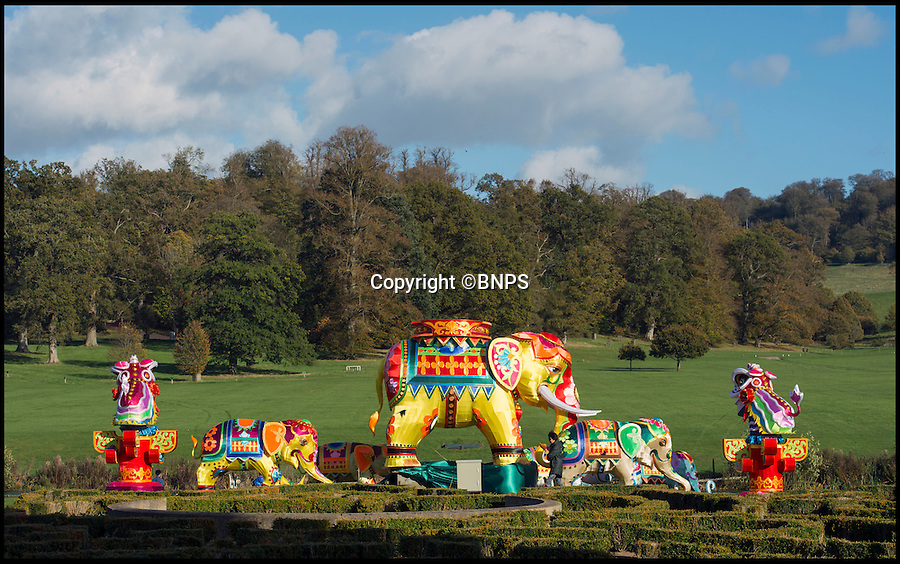 BNPS.co.uk (01202 558833)<br /> Pic: PhilYeomans/BNPS<br /> <br /> Skilled artists from Zigong put the finishing touches to a herd of Elephants.<br /> <br /> The largest Chinese 'Festival of Light' seen in Europe is taking shape at the Longleat House in Wiltshire - A small army of over 50 skillled workers have flown in from the remote village of Zigong in central China to create the stunning spectacle.<br /> <br /> Among the different scenes are a 20-metre tall Chinese temple, a 70-metre-long dragon, created using more than 10,000 porcelain cups, bowls, plates and dishes, and the mythical qilin – a chimerical hooved creature with the head of a lion – featuring more than 30,000 glass phials filled with coloured liquid.<br /> <br /> Massive traditional Chinese masks are also featured and there is also a bamboo forest which is home to a family of life-size pandas, giant elephants, zebras, lions and deer as well as giant lotus flowers floating on the lake.<br /> <br /> Filled with thousands of LED lights and handmade by a team of 50 highly-skilled craftsmen from Zigong in China's Sichuan province, the lanterns recreate a magical world of myths and legends.<br /> <br /> Set amid the beautiful backdrop of the landscaped grounds and gardens surrounding Longleat House, the lit structures also spill out on to Half Mile Lake to create a stunning and enchanting experience for visitors.<br /> <br /> It's the first time a festival of this size has taken place in the UK and the Chinese team behind the spectacular event believe its size and complexity make it unique throughout Europe.