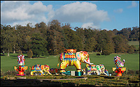 BNPS.co.uk (01202 558833)<br /> Pic: PhilYeomans/BNPS<br /> <br /> Skilled artists from Zigong put the finishing touches to a herd of Elephants.<br /> <br /> The largest Chinese 'Festival of Light' seen in Europe is taking shape at the Longleat House in Wiltshire - A small army of over 50 skillled workers have flown in from the remote village of Zigong in central China to create the stunning spectacle.<br /> <br /> Among the different scenes are a 20-metre tall Chinese temple, a 70-metre-long dragon, created using more than 10,000 porcelain cups, bowls, plates and dishes, and the mythical qilin &ndash; a chimerical hooved creature with the head of a lion &ndash; featuring more than 30,000 glass phials filled with coloured liquid.<br /> <br /> Massive traditional Chinese masks are also featured and there is also a bamboo forest which is home to a family of life-size pandas, giant elephants, zebras, lions and deer as well as giant lotus flowers floating on the lake.<br /> <br /> Filled with thousands of LED lights and handmade by a team of 50 highly-skilled craftsmen from Zigong in China's Sichuan province, the lanterns recreate a magical world of myths and legends.<br /> <br /> Set amid the beautiful backdrop of the landscaped grounds and gardens surrounding Longleat House, the lit structures also spill out on to Half Mile Lake to create a stunning and enchanting experience for visitors.<br /> <br /> It&rsquo;s the first time a festival of this size has taken place in the UK and the Chinese team behind the spectacular event believe its size and complexity make it unique throughout Europe.