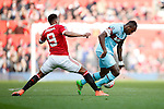 Anthony Martial of Manchester United tackles West Ham's Michail Antonio during the Emirates FA Cup match at Old Trafford. Photo credit should read: Philip Oldham/Sportimage