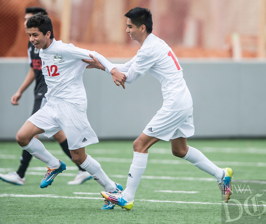 NWA Democrat-Gazette/ANTHONY REYES • @NWATONYR<br /> Salvador Gonzalez (12), Springdale freshman, celebrates a goal with David Portilla (13), sophomore, against Fort Smith Northside Thursday, March 19, 2015 at Bulldog Stadium in Springdale. The Bulldogs won on penalty kicks after a 2-2 tie at the end of regulation.