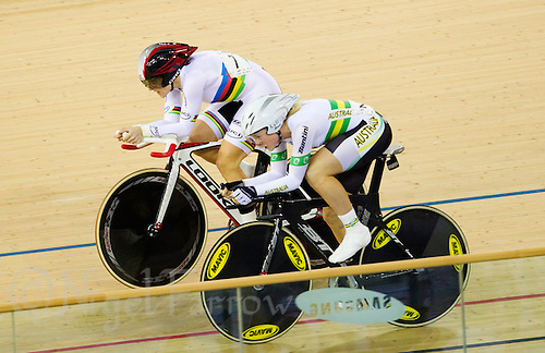19 FEB 2012 - LONDON, GBR - Canada's Tara Whitten (CAN) (top with black and red helmet) overtakes Australia's Annette Edmondson (AUS) during the Individual Pursuit round of the Women's Omnium at the UCI Track Cycling World Cup, and London Prepares test event for the 2012 Olympic Games, in the Olympic Park Velodrome in Stratford, London, Great Britain (PHOTO (C) 2012 NIGEL FARROW)