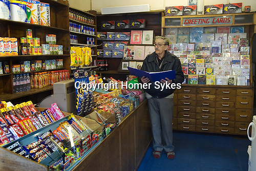 Old fashioned corner shop belonging to 79 year old David Brown the proprietor since 1953 when he took over after leaving the army. Brentwood Middlesex London. With stock taking book.