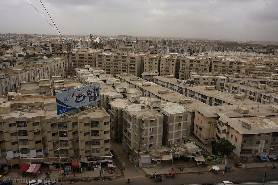 New housing developments in Gulshan-e-Jouhar neighborhood of Karachi.  The new middle class, fueled by the growth in the IT, telecommunications and service/banking industries, is pushing the rapid growth of the city in new directions and changing the very face and culture of the city itself.  This new class, consummerist, career oriented and merchentile, remains religiously conservative but demands all the trappings and comforts of modern life.