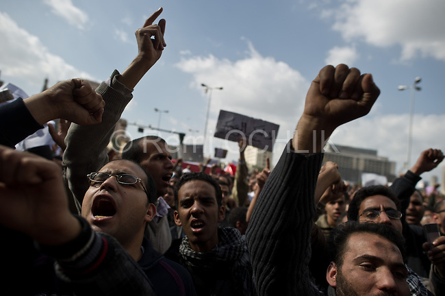 """Remi OCHLIK/IP3 -  Cairo on january 31 - Tens of thousands of people in Egypt are taking part in a seventh day of protests calling for the country's leader to step down. Crowds have been growing in Cairo's Tahrir Square and in other cities, with many shouting slogans and waving placards calling for Hosni Mubarak's downfall. Far greater numbers are expected to hit the streets tomorrow for a mass rally billed as the """"protest of the millions"""".There have been some reports of 25,000 people in Tahrir Square but the realistic estimate is between 10,000 and 15,000."""