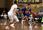 SIOUX FALLS, SD - NOVEMBER 26:  Andre Wallace #20 from South Dakota State University pushes the ball past Jason Williams #4 from East Tennessee State University during their game at the Sanford Pentagon Saturday evening in Sioux Falls. (Photo by Dave Eggen/Inertia)