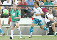 Heather O'Reilly #10 of Abby's XI sends over a cross past Aya Miyama #24 of Marta's XI during the WPS All-Star game at KSU Stadium in Kennesaw, Georgia on June 30 2010. Marta XI won 5-2.