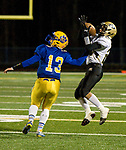 SEYMOUR, CT-112217JS02- Woodland's Matt Mills (22) pulls in a 32-yard reception in front of Seymour's Ian Sadick (13) during their game Wednesday at Seymour High School. Seymour defeated the Hawks  56-8. Jim Shannon Republican-American