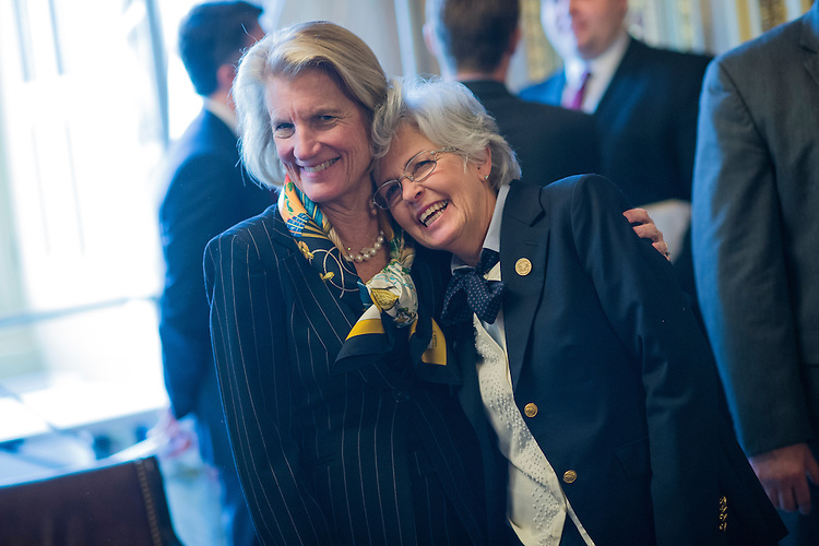 UNITED STATES - FEBRUARY 15: Sen. Shelley Moore Capito, R-W.Va., left, greets Andrea Pendleton, mayor of Rainelle, W.Va., in the Capitol's Senate Reception Room, February 15, 2017. (Photo By Tom Williams/CQ Roll Call)