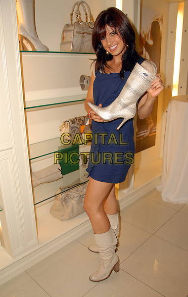 GUEST.Launch Of Carmen Steffens 2008 Fall/Winter Collection held at Westfields Fashion Square Mall, Sherman Oaks, California, USA, 11 August 2008..full length blue dress boot shoes  .CAP/ADM/FS.©Faye Sadou/Admedia/Capital Pictures