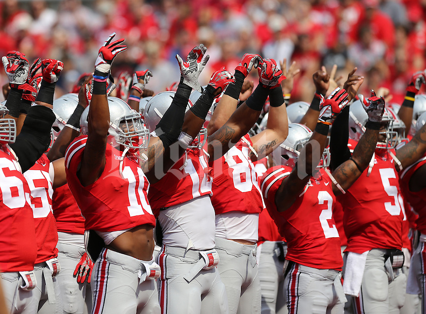 "Ohio State football players run through the ""Quick Cal"" drill prior to the NCAA football game against San Diego State at Ohio Stadium in Columbus on Sept. 7, 2013. (Adam Cairns / The Columbus Dispatch)"
