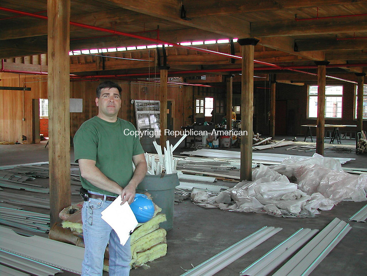 THOMASTON, CT - 23 April 2008 - 042308KM01 - Tom Battiste of Litchfield poses in the former Star S. Manufacturing building at 10 Marine St. in Thomaston. Battiste is partnering with Rick Judd of Litchfield to restore the 1925 facility into a commercial building for medical offices. Kurt Moffett Republican-American
