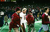 Washington Redskins quarterback Jay Schroeder (10) is walked off the field by Redskins trainers after enduring a bruising day in the NFC Championship Game against the New York Giants in Giants Stadium in East Rutherford, New Jersey on Sunday, January 11, 1987.  The Giants won the game, and a berth in Super Bowl XXI, 17 - 0.<br /> Credit: Howard L. Sachs / CNP