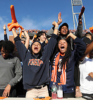 ANDREW SHURTLEFF/THE DAILY PROGRESS <br /> Virginia fans celebrate a touchdown during the game Friday in Charlottesville. Virginia defeated Virginia Tech 39-30 to win the Commonwealth Clash. Virginia defeated Virginia Tech 39-30 to win the Commonwealth Clash.