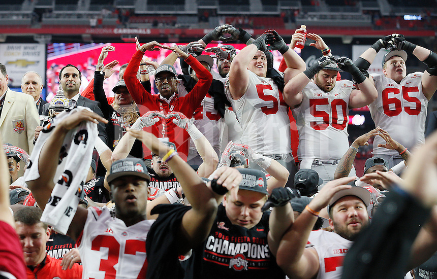 "Ohio State players sing ""Carmen Ohio"" following Ohio State's 44-28 win over the Notre Dame Fighting Irish in the Battlefrog Fiesta Bowl at University of Phoenix Stadium in Glendale, Arizona on Jan. 1, 2016. (Adam Cairns / The Columbus Dispatch)"