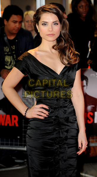 Charlotte Riley.Arrivals to 'This Means War' UK premiere held at the Odeon, Kensington, London, England..January 30th, 2012.half length dress black ruched hand on hip.CAP/WIZ.© Wizard/Capital Pictures.
